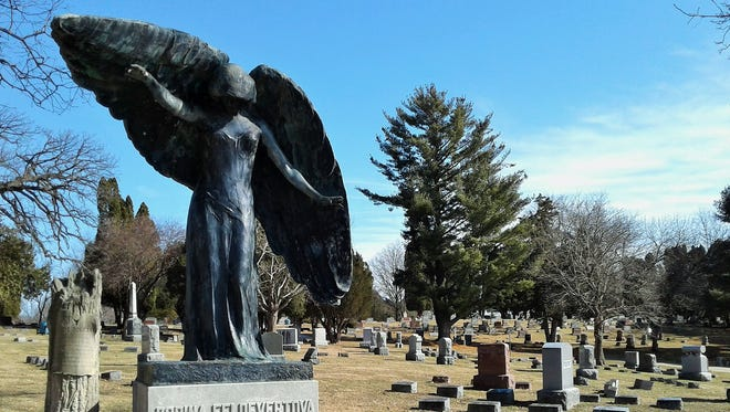 The well-known Black Angel presides over this section of Oakland Cemetery in Iowa City.  The large bronze statue was sculpted in Chicago and erected here in 1913 as a memorial to Nicholas Feldevert. Over years, the statue oxidized and its resulting greenish-black patina has sparked local legends and superstitions.