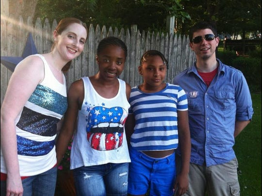Meg and Zach Burczynski with their two Fresh Air children, Wandalyse Gonzalez, right, and Azaria Wise. The Apalachin couple have hosted youngsters for seven years and are strong believers in the program.