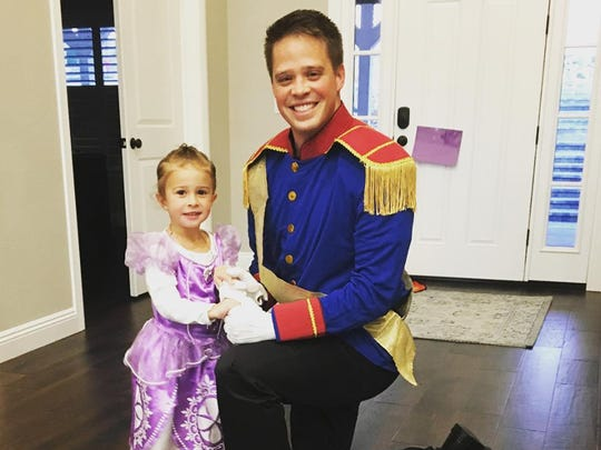Taylor Orton and his daughter Emmeline dressed for Halloween.