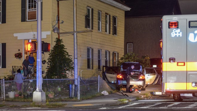 Worcester police search a car in connection to a pursuit in the city early Saturday morning that led to an arrest.