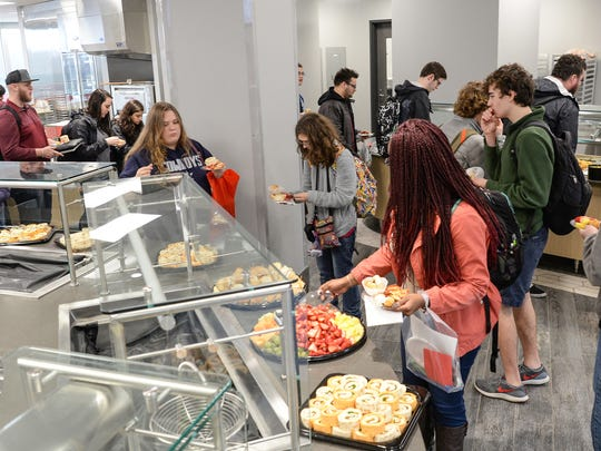 Tri-County Technical College students get food to eat in the cafeteria of the newly opened Student Success Center, following the Ribbon Cutting and Dedication Ceremony in Pendleton on Friday, January 12, 2018.