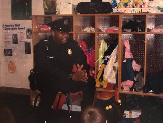 Detroit Police Officer Waldis Johnson speaks with metro