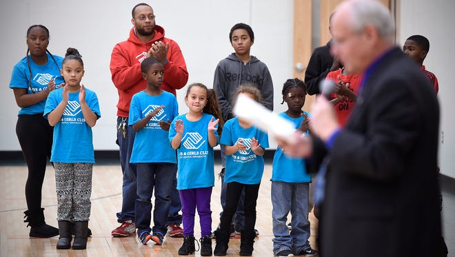 Children and staff members applaud during a ribbon cutting ceremony Thursday for the new gymnasium addition at the Roosevelt Boys & Girls Club in St. Cloud.