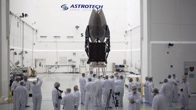 Members of the news media in January were given an opportunity for an up-close look at the TDRS-L spacecraft undergoing preflight processing inside the Astrotech payload processing facility in Titusville.