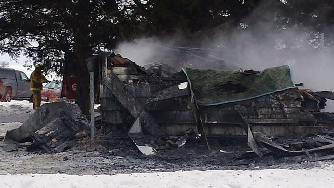 The scene of a Jan. 24 fire that destroyed a house in Arlington, Iowa, and killed at least five, according to  authorities.