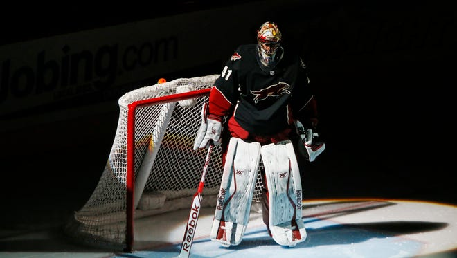 Phoenix Coyotes goalie Mike Smith prepares for a game against the Dallas Stars on Feb. 4, 2014 in Glendale.