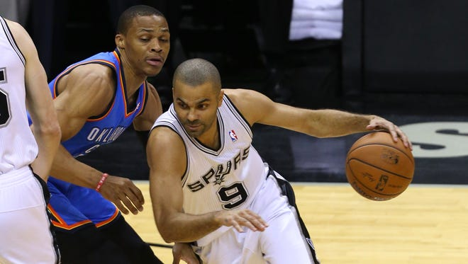 Tony Parker drives around Russell Westbrook in Game Five of the Western Conference Finals.