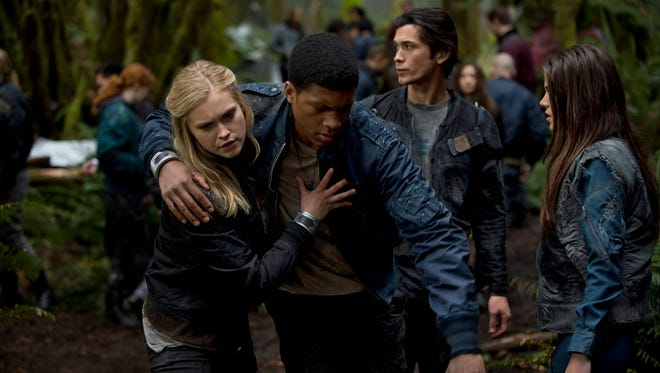 The '100' youth group: Clarke (Eliza Taylor, left) Wells (Eli Goree), Bellamy (Bob Morley) and Octavia (Marie Avgeropoulos).