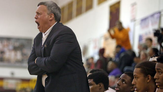 Coach Bob Cimmino of Mount Vernon High School in New York yells to his team during a varsity basketball game Feb. 20.