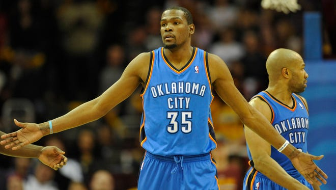 Oklahoma City Thunder forward Kevin Durant (35) reacts in the fourth quarter against the Cleveland Cavaliers at Quicken Loans Arena.