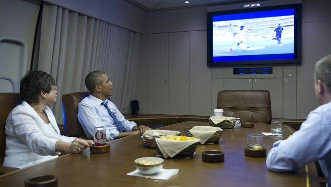 President Obama and aides watch the World Cup.