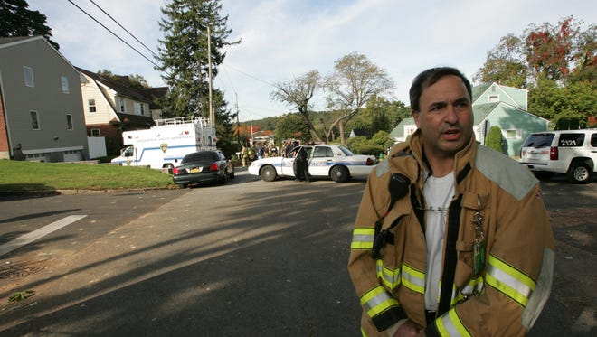 Fairview Deputy Chief Anthony LoGiudice spoke to the media at the scene of a fire in Greenburgh on Oct. 14, 2010.