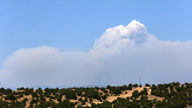 Smoke from the 416 Fire near Durango, Colorado, seen here on  June 11 in Farmington, is often on the horizon here and is expected to get closer at times this week.