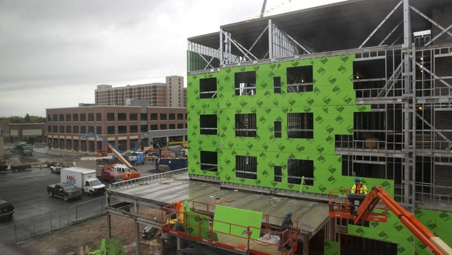 A five-story hotel under construction in College Town.