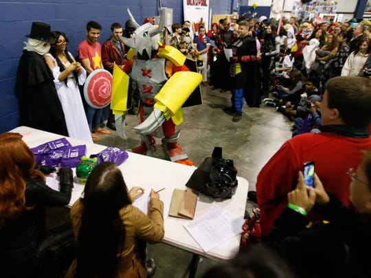 Luis Valdez of Milford presents his homemade WarGreymon costume from Digimon to judges  during the costume contest as part of the Galactic Con in Middletown Saturday.