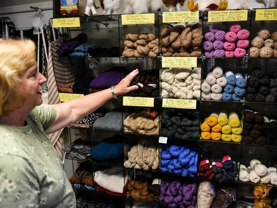 Sharon Musser talks about the fleece from alpacas that is for sale at Shardick Suri Farm in Swatara Township on Thursday, June 16, 2016.