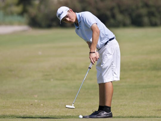 Central Valley Christian's Brian Stark putts on the 12th green during the Central Area Golf Tournament at River Island Country Club in Porterville on Tuesday, May 10, 2016.