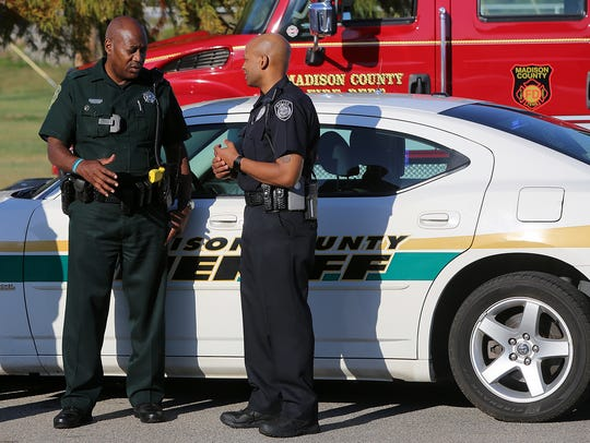 Madison County Sheriff's Deputy Terry Stewart (left),