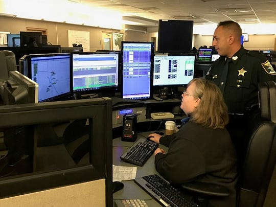 Carmine Marceno, undersheriff for the Lee County Sheriff's Office, watches dispatcher Donna Young check information on a call. The communication's department took part in a mock disaster preparedness drill on Tuesday.