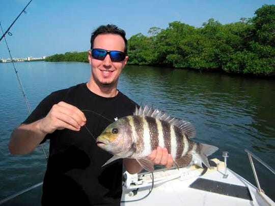 FILE: Gordon Levy with a 16-inch sheepshead, caught