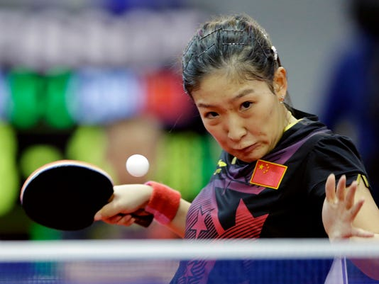 FILE In this Oct. 2, 2014, file photo, China's Liu Shiwen returns a ball against North Korea's Ri Mi Gyong during their women's single table tennis match at the 17th Incheon Asian Games in Suwon, South Korea. The exodus of Chinese players playing for other countries is partly explained by the intense competition to make the national team. The current No. 1 player in the world, for instance, China's Liu Shiwen, didn't get one of her country's two spots for singles. (AP Photo/Lee Jin-man, File)
