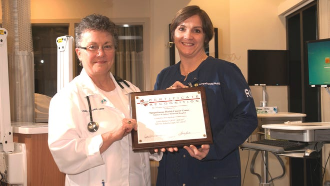 Laura Balmer, left, and Sabrina Scharborough, were recently honored with the Oncology Nursing Certification Corp. Employer Recognition Award for having 100 percent of the Soldiers + Sailors Memorial Health Cancer Center register nurses who treat outpatient cases achieve advanced oncology certification.