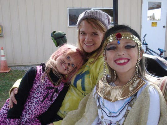 Stephanie Latier poses for a photo with her two daughters, Lily, left, and Emma, in October 2012.