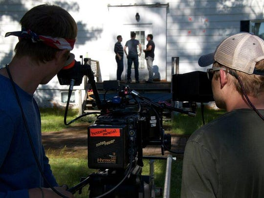 """Director Edd Benda (right) and Alex Bell, director of photography, plan the composition of a shot in """"Superior."""""""