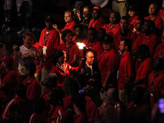 Monroe resident Julie Kelly, 21, a Rowan University senior and member of Rowan Unified Sports, runs with Special Olympics New Jersey athlete Sean Silver at the Opening Ceremony for the 2014 USA Special Olympics. Both were given the honor of lighting the Special Olympics torch.