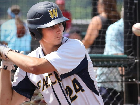 Whitnall's Joe Tilley passes on a head-high pitch in action from this season. Tilley earned honorable-mention all-Woodland East Division this season and is a key returnee for next year.