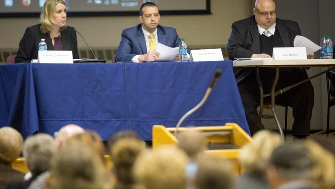 Members of the Indiana State Distressed Unit Appeals Board talks with the Muncie community on May 1 about the State takeover of Muncie Community Schools.