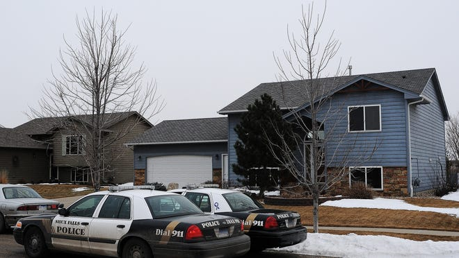 Law enforcement officers on scene on the 5900 block of South Hallow Avenue after a shooting in Lennox, S.D., on Thursday, Feb. 12, 2015, in southwest Sioux Falls, S.D.