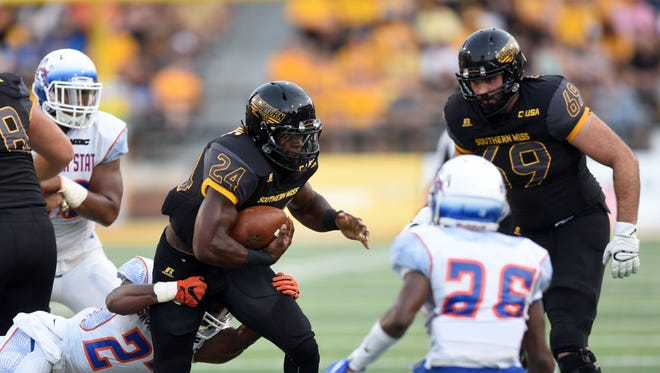 Southern Miss running back George Payne pushes for extra yards against Savannah State in M.M. Roberts Stadium on Saturday, Sept. 10, 2016.