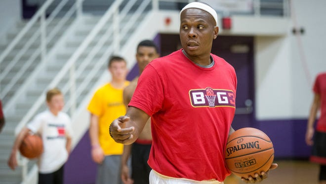 Bonzi Wells works with Central's basketball team June 26 at the Muncie Fieldhouse. Wells worked alongside Jeremiah Davis and coach Chandler Thompson.