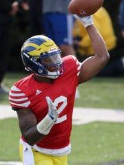 Delaware quarterback Darius Wade throws during Delaware's
