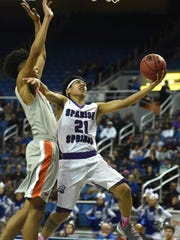 Spanish Springs' Leo Grass shoots with Bishop Gorman's Isaiah Cottrell covering him in the first half of the semifinals game at the 2018 NIAA 4A State Basketball Championships at Lawlor Events Center on Feb. 22, 2018.