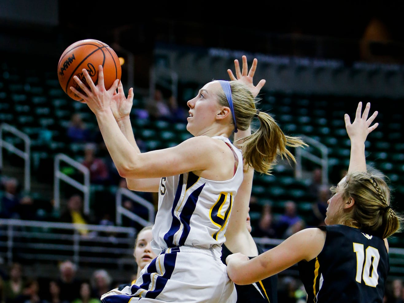 P-W's Brenna Wirth connects from the paint against Maple City Glen Lake Thursday, March 16, 2017, during the Class B Semifinal at the Breslin in East Lansing. P-W won 64-51.