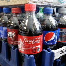 FILE - This Feb. 13, 2014 file photo shows sugary sodas in Sacramento, Calif.