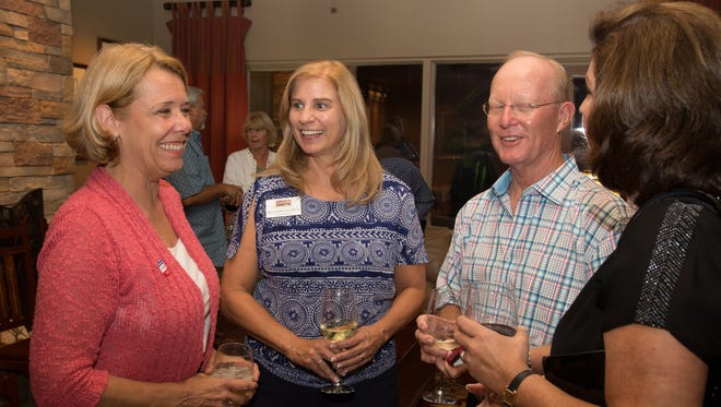Linda Milhaven, Rebecca Grossman, Eric Larson and Jennifer Petersen talk before the election results in Tuesday evening, August When the results did come in Milhaven and Petersen were number one and two for the Scottsdale Town Council.