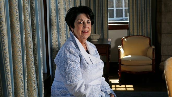 Gloria Esteves, 70, was diagnosed with advanced uterine cancer in 2003. She began going to Ren-Shen Healing for oncology massages about five years ago to help with pain and other side effects of chemo and anti-cancer drugs she was taking. Esteves is photographed in her home in Sleepy Hollow.