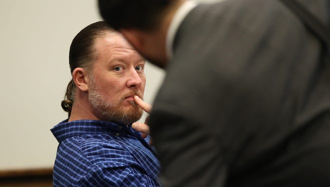 George Burch looks toward the gallery as his lawyer, Scott Stebbins, gets ready for afternoon testimony in Burch's trial for the murder of Nicole VanderHeyden.