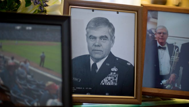 A photo of Ret. Lt. Col. Ronald Westbrook sits on the coffee table in his home in Chickamauga, Ga.