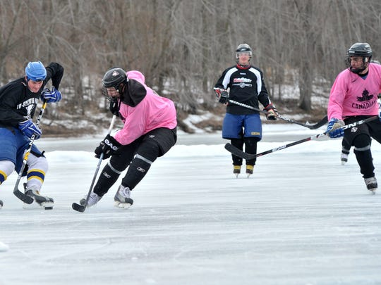 Hockey lovers team up to compete Saturday during the Leinenkugel's Classic Pond Hockey Tournament on Sunny Vale Lake in Wausau.