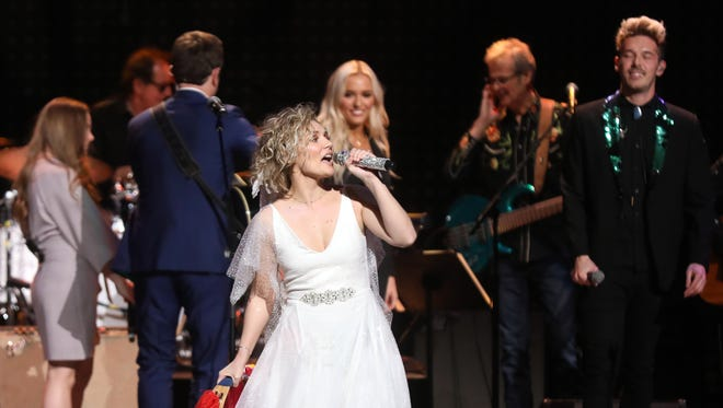 Clare Bowen participates in the final US performance by the cast of the TV show Nashville Sunday March 25, 2018 at the Grand Ole Opry.