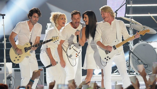 """Johnny """"Duke"""" Lippincott (far left) performs with Little Big Town in 2014 at the CMT Music Awards in Nashville."""