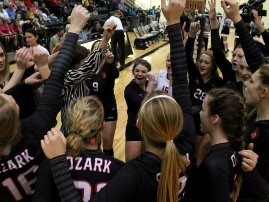 The Ozark Tigers volleyball team breaks huddle prior