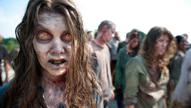 """Zombies appear in a scene from the second season of the AMC original series """"The Walking Dead."""" Crews have been filming the new episodes in Georgia."""