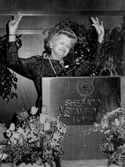 Former First Lady Betty Ford acknowledges the audience's applause as she speaks in Stamford, Conn., in May 1987, discussing her battle with breast cancer and addiction.