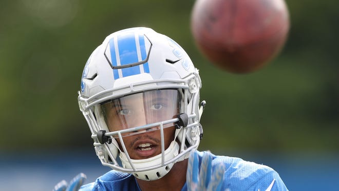 Lions receiver Kenny Golladay catches balls from a machine during practice Sunday, July 30, 2017 in Allen Park.