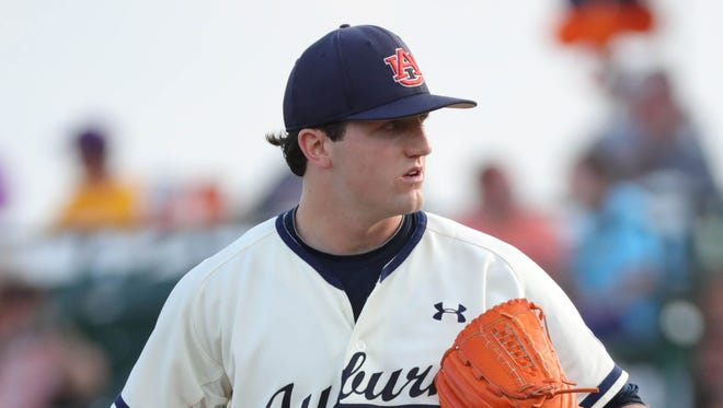 Casey Mize pitches against LSU on May 18 in Auburn, Ala.